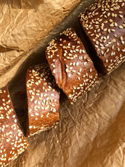 Bread with sesame seeds on a background of brown paper.