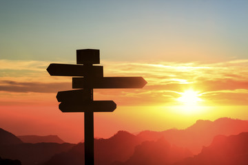 Silhouette of a signpost in a colorful sunset