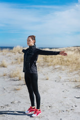 Woman doing stretching exercises to warm up