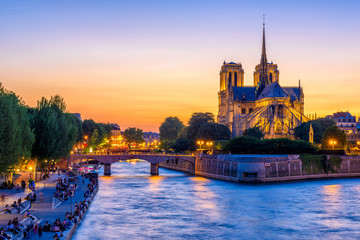 Sunset view of Cathedral Notre Dame de Paris, island Cite and river Seine in Paris, France
