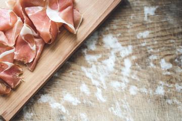 Spanish  prosciutto on wooden board