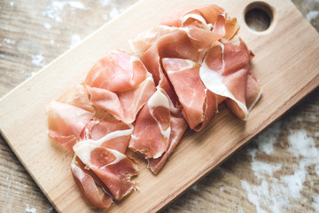 Spanish  prosciutto on wooden board