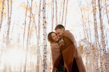 embrace couple in love in autumn