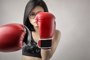 Girl boxing with red gloves