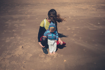 Mother with toddelr on the beach