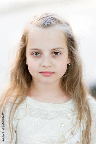 c106fba31 Girl with long hair on calm face, light background. Kid girl long ...