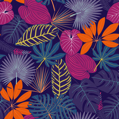 Seamless pattern from tropical leaves. multi-colored tropical leaves pattern