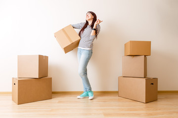 Image of young woman among cardboard boxes