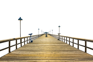 Perspective view of a fishing pier wooden isolated on white background. Concept of simplicity, purpose, direction and infinity.