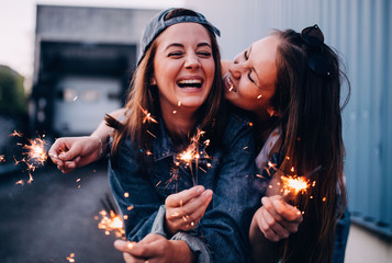 best friends enjoying time together with sparklers