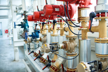 Background image of interior of clean production workshop at modern factory, machine units with red valves and pipes in focus, copy space
