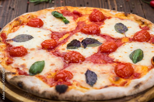 Rustic Italian Pizza Margarita With Mozzarella Cherry Tomatoes And Basil Leaves On Wooden Background