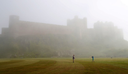 People play cricket in front of Bamburgh Castle in Northumberland
