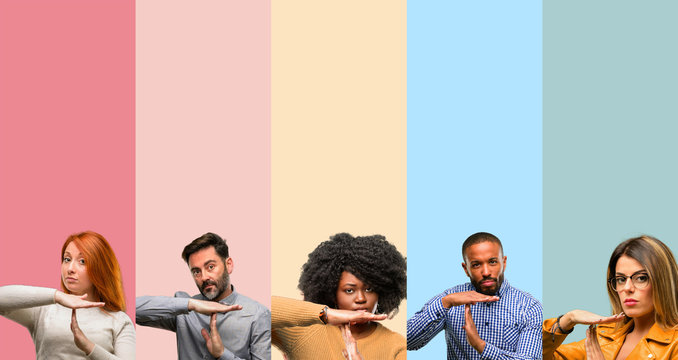 Cool group of people, woman and man serious making a time out gesture with hands