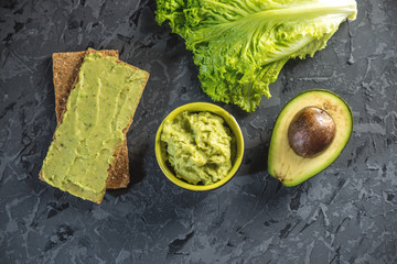 Mexican cold appetizer made of pureed avocado pulp with bread and vegetables. Concept green healthy vegetarian Breakfast