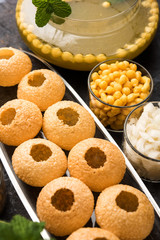 Pani Puri OR Golgappa is a popular Indian Chat menu, selective focus