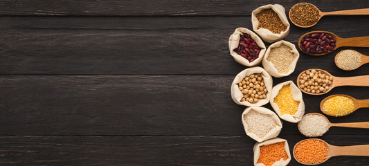 Various gluten free groats on wooden background, copy space
