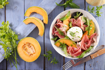 Wall Mural - melon, mozzarella and prosciutto ham salad