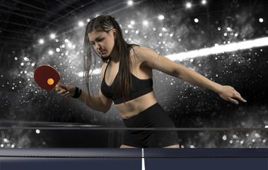 Portrait woman playing tennis on black