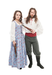 Beautiful couple woman and man in medieval clothes with pistols isolated