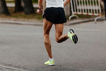 Wall Mural - men jogger athlete running city street marathon