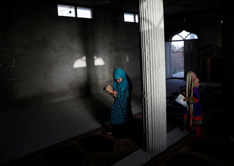 Afghan girls arrive to read the Koran in a madrasa, or religious school, during the Muslim holy month of Ramadan in Kabul