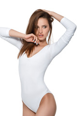 beautiful sexy woman with perfect body in white bodysuit