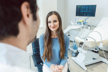 Woman visiting the gynecologist doctor in his office