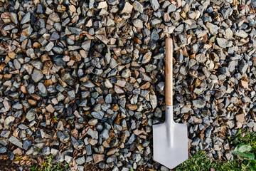 sapper shovel on the background of stones