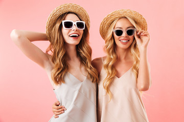 Portrait of two pretty young women in summer clothes