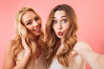 Two pretty young women with long hair