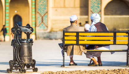 Two old man sitting on bench in Yazd - Iran