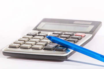 Business calculator and blue pen on a white background