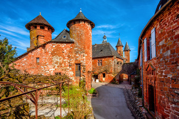 Collonges-la-Rouge, red brick houses and towerd of the Old Town, France