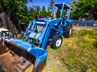 Old Blue Tractor With Front Scoop & Backhoe