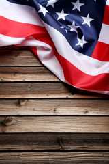 American flag on brown wooden table