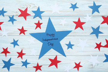 Paper star with inscription Happy Independence Day on wooden table