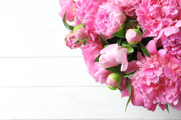 Beautiful fragrant peony flowers on light background
