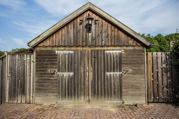 detail of a brown wooden vintage barn on a farm