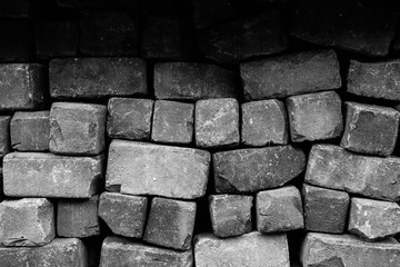 Rough loose brick wall background texture black and white