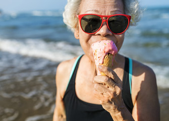 Senior woman eating an ice cream cone