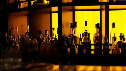 amber backlit generic bar bottles