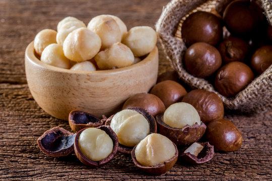 Macadamia nut on wooden table.