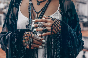 stylish woman hands close up with boho accessories