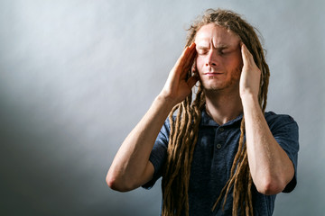 Young man feeling stressed on a dark background