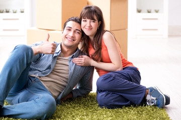 Young family moving to new house after final payment