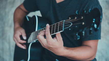 man playing guitar in vintage tone style,music studio