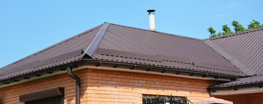 Problem areas for metal roof and rain gutter waterproofing. Guttering, gutters, metal roofing house panorama