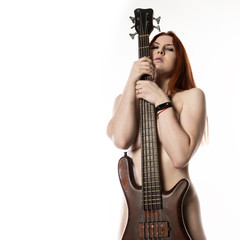 nude rock woman holding electric guitar on a white background. free space for text