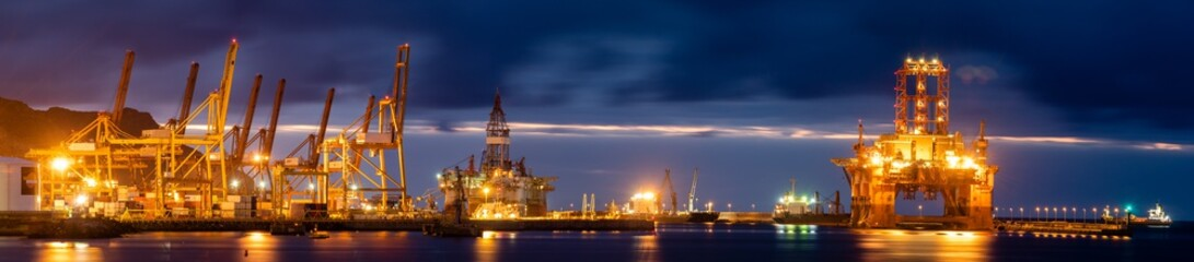 night seaport, container terminal and oil rig